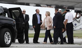 Democratic presidential candidate Hillary Clinton steps off of her campaign plane at Cleveland Hopkins International Airport in Cleveland, Wednesday, Aug. 17, 2016, en route to a tour and campaign event at John Marshall High School in Cleveland. (AP Photo/Carolyn Kaster)