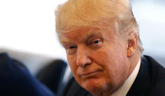 Republican presidential candidate Donald Trump smiles as he participates in a roundtable discussion on national security in his offices in Trump Tower in New York, Wednesday, Aug. 17, 2016. (AP Photo/Gerald Herbert)