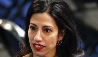 Huma Abedin, an aide to Democratic presidential candidate Hillary Clinton, talks on the floor of the Democratic National Convention in Philadelphia, Tuesday, July 26, 2016. (AP Photo/Paul Sancya)