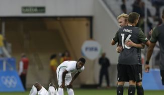 Germany's players, right, celebrate after qualifying for the final at the end of a semifinal match of the men's Olympic football tournament against Nigeria in Sao Paulo, Wednesday Aug. 17, 2016. Germany won 2-0 and will play the final against Brazil.(AP Photo/Leo Correa)
