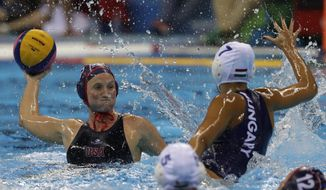 United States' Courtney Mathewson,left, shoot the ball as Hungary's Anna Ille, right, goes to block during their women's semifinal water polo match at the 2016 Summer Olympics in Rio de Janeiro, Brazil, Wednesday, Aug. 17, 2016. (AP Photo/Eduardo Verdugo)