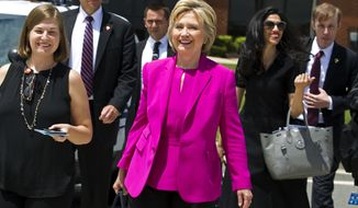 Democratic presidential candidate Hillary Clinton,  followed by aide Huma Abedin, second from right, walks on the tarmac as she arrives to board Air Force One at Andrews Air Force Base, Md., Tuesday, July 5, 2016. President Barack Obama and Clinton are traveling to Charlotte, N.C. to campaign together. ( AP Photo/Jose Luis Magana)