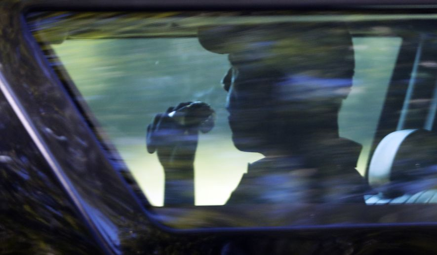 President Barack Obama is seated in the presidential vehicle as his motorcade leaves after playing a round of golf at Farm Neck Golf Course in Oak Bluffs, Mass., on Martha's Vineyard, Thursday, Aug. 18, 2016. (AP Photo/Manuel Balce Ceneta)