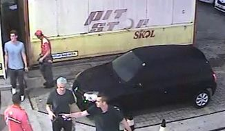 In this Sunday, Aug. 14, 2016 frame from surveillance video released by Brazil Police, swimmer Ryan Lochte, second from right, of the United States, and teammates, appear at a gas station during the 2016 Summer Olympics in Rio de Janeiro, Brazil. A top Brazil police official said the swimmers damaged property at the gas station. (Brazil Police via AP) ** FILE **