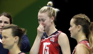 United States' Kim Hill reacts after losing a women's semifinal volleyball match against Serbia at the 2016 Summer Olympics in Rio de Janeiro, Brazil, Thursday, Aug. 18, 2016. (AP Photo/Matt Rourke)