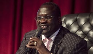 In this file photo of Wednesday, Oct. 13, 2010, Dr. Riek Machar, then-vice president of the Government of South Sudan, presides over an all-southern-parties meeting in Juba, Sudan South. Sudan's rebel leader Machar  has fled the country, a spokesman for his party said Thursday, Aug. 18. 2016. (AP Photo/Pete Muller-file)