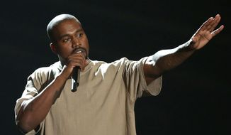 """In this Sunday, Aug. 30, 2015, file photo, Kanye West accepts the video vanguard award at the MTV Video Music Awards at the Microsoft Theater in Los Angeles. West announced on Twitter Aug. 17, 2016, that he will open 21 temporary """"Pablo"""" stores worldwide on the weekend of Aug. 20. (Photo by Matt Sayles/Invision/AP, File)"""