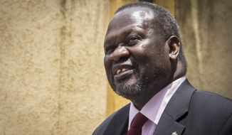 FILE--- In this file photo of Monday, Aug. 31, 2015. South Sudan's rebel leader Riek Machar.  Sudan's rebel leader Machar  has fled the country, a spokesman for his party said Thursday Aug. 18. 2016 . The former First Vice President Riek Machar has gone to a safe country in the neighboring East African region, Mabior Garang, a spokesperson for the SPLM-IO party, said in a posting on Facebook..(Photo/Mulugeta Ayene-file)