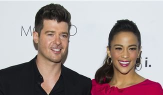"Robin Thicke first met actress Paula Patton in 1991 at an under-21 hip-hop club on the Sunset Strip in Los Angeles, when he asked her to dance. According to Thicke, he sang Stevie Wonder's ""Jungle Fever"" to her as they danced. Thicke began dating Patton at the age of 16. They were married in 2005, and have a son, Julian Fuego Thicke, born in 2010. Thicke and Patton separated in February 2014, after 21 years together and almost nine years of marriage. On October 9, 2014, Paula Patton officially filed for divorce. The divorce was finalized on March 20, 2015. (AP Photo)"
