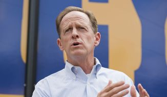U.S. Sen. Pat Toomey, R-Pa., speaks to supporters gathered outside Sara's Restaurant near Erie, Pa., during a Pennsylvania campaign stop on Friday, Aug. 19, 2016, in Millcreek Township, Pa. (Andy Colwell/Erie Times-News via AP) ** FILE **