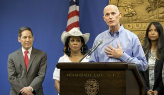 In this Aug. 4, 2016, file photo, Florida Gov. Rick Scott, foreground, speaks during a news conference along with Centers for Disease Control and Prevention Director Dr. Tom Frieden, left, Rep. Frederica Wilson, D-Florida, and Fla. Surgeon General and Secretary, Dr. Celeste Philip, far right, in Doral, Fla.  South Beach has been identified as second site of Zika transmission by mosquitoes on the U.S. mainland, Florida officials said Friday, Aug. 19. (AP Photo/Wilfredo Lee)
