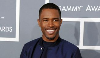"""In this Feb. 10, 2013 file photo, Frank Ocean arrives at the 55th annual Grammy Awards in Los Angeles. Apple Music has released new and long-awaited music from Grammy award-winning singer, Ocean. The company tweeted a link to the music video """"Endless"""" by the R&B artist on Thursday night, Aug. 18, 2016. (Photo by Jordan Strauss/Invision/AP, File)"""