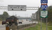 In this Sept. 29, 2011, file photo, vehicles drive along the Ohio Turnpike in Strongsville, Ohio. The Trump White House is set to propose a federal budget plan that calls for loosening restrictions on states' tolling of interstate highways, Bloomberg News reported on May 23, 2017. (AP Photo/Mark Duncan, File) **FILE**