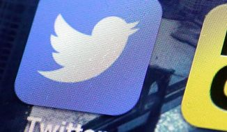 This Friday, Oct. 18, 2013, file photo, shows a Twitter app on an iPhone screen in New York. (AP Photo/Richard Drew, File)
