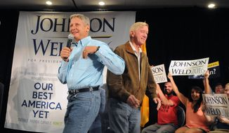 Libertarian presidential candidate and former New Mexico Gov. Gary Johnson. left, takes the stage at the Albuquerque Convention Center after being introduced by his running mate Bill Weld during a campaign rally Saturday Aug. 20, 2016, in Alburquerque, N.M. (Jim Thompson/The Albuquerque Journal via AP)