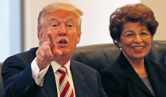 Republican presidential candidate Donald Trump holds a Hispanic advisory roundtable meeting in New York, Saturday, Aug. 20, 2016. At right is Jovita Carranza, former Small Business Administration Deputy Administrator. (AP Photo/Gerald Herbert)