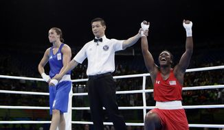 United States' Claressa Maria Shields, right, reacts as she won her gold medal for the women's middleweight 75-kg boxing against Netherlands' Nouchka Fontijn at the 2016 Summer Olympics in Rio de Janeiro, Brazil, Sunday, Aug. 21, 2016. (AP Photo/Frank Franklin II)