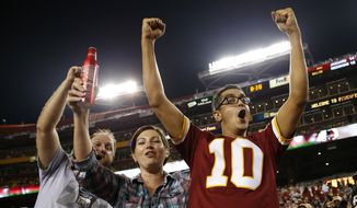 Washington Redskins fans cheer during the second half of an NFL preseason football game against the Jacksonville Jaguars in Landover, Md., Thursday, Sept. 3, 2015. (AP Photo/Alex Brandon) **FILE**