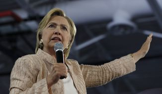 In this Aug. 17, 2016, file photo, Democratic presidential candidate Hillary Clinton speaks at campaign event at John Marshall High School in Cleveland. (AP Photo/Carolyn Kaster, File)