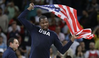 United States' Kevin Durant (5) celebrates winning the men's basketball gold medal at the 2016 Summer Olympics in Rio de Janeiro, Brazil, Sunday, Aug. 21, 2016. (AP Photo/Eric Gay)