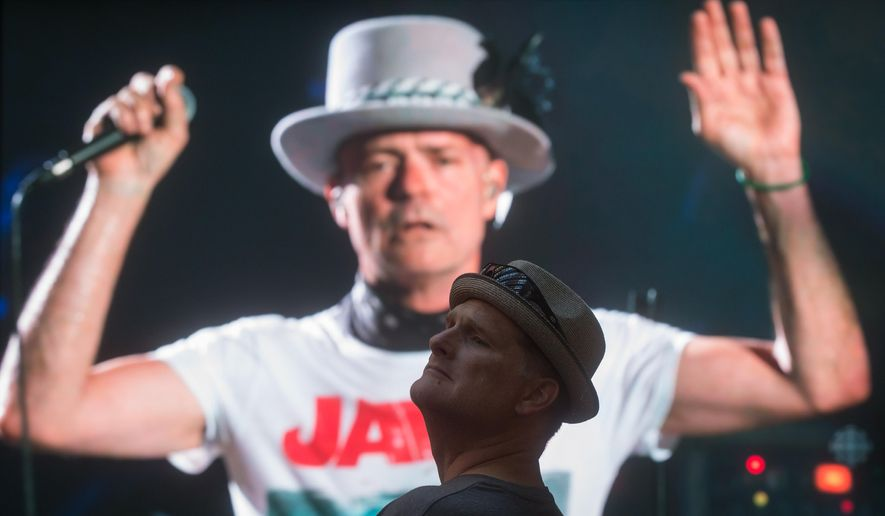 Car Rental Kingston Ontario >> Lead singer Gord Downie is seen performing on a screen as a man watches during a viewing party ...