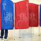 "A poll reveals that 80 percent of Americans favor ""requiring all voters to provide photo identification at their voting place in order to vote."" (Associated Press)"