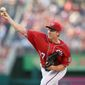 "While he said he can ""gut it through,"" Washington Nationals pitcher Stephen Strasburg was put on the 15-day disabled list Monday with a sore right elbow. (Associated Press)"