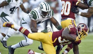 Washington Redskins running back Matt Jones (31) is tackled by New York Jets outside linebacker Jordan Jenkins (48)  during the first half of an NFL preseason football game Friday, Aug. 19, 2016, in Landover, Md. (AP Photo/Nick Wass)