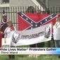 "A group of armed protesters gathered in front the NAACP offices in Houston on Sunday to declare ""White Lives Matter."" (KPRC)"