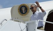 President Barack Obama waves as he steps off Air Force One at Baton Rouge Metropolitan Airport in Baton Rouge, La., Tuesday, Aug. 23, 2016. Obama is traveling to the area to survey the flood damage. (AP Photo/Susan Walsh)