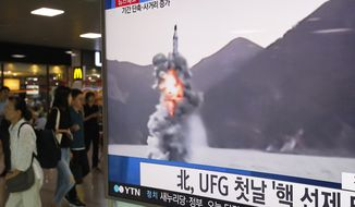 "People pass by a TV news program showing a file footage of North Korea's ballistic missile that the North claimed to have launched from underwater, at Seoul Railway station in Seoul, South Korea, Wednesday, Aug. 24, 2016. North Korea on Wednesday fired a ballistic missile from a submarine into the sea in an apparent protest against the start of annual South Korea-U.S. military drills, Seoul's military said. The letters read ""North Korea fired a missile during UFG, Ulchi Freedom Guardian."" (AP Photo/Ahn Young-joon)"