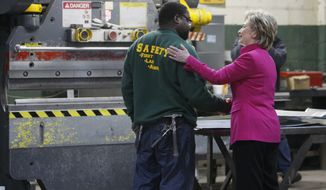 Hillary Rodham Clinton greets a worker as she tours the factory of William J. Donovan sheet metal contractors in Philadelphia, Tuesday, April 1, 2008. (AP Photo/Charles Dharapak)