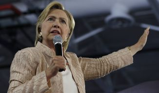 FILE - In this Aug. 17, 2016 file photo, Democratic presidential candidate Hillary Clinton speaks at campaign event at John Marshall High School in Cleveland.  (AP Photo/Carolyn Kaster, File)