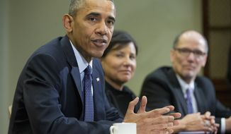 President Barack Obama, with Commerce Secretary Penny Pritzker, center, and Labor Secretary Thomas E. Perez, speaks during a meeting with members of his economic team in the Roosevelt Room of the White House in Washington, Friday, March 4, 2016. Obama spoke about U.S. employers adding 242,000 workers in February, driving another solid month for the resilient American job market. (AP Photo/Pablo Martinez Monsivais)