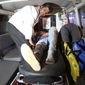 A wounded person is treated in an ambulance after a complex Taliban attack on the campus of the American University in the Afghan capital Kabul on Wednesday, Aug. 24, 2016. We are trying to assess the situation, President Mark English told The Associated Press. (AP Photo/Rahmat Gul)