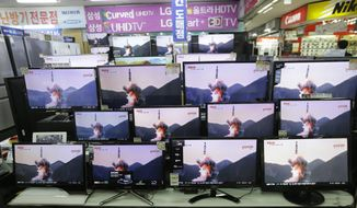 TV screens show file footage of a similar North Korea's ballistic missile that North Korea claimed to have launched from underwater at the Yongsan Electronic store in Seoul, South Korea, Wednesday, Aug. 24, 2016. A North Korean ballistic missile fired from a submarine Wednesday flew about 500 kilometers (310 miles) in the longest flight by that type of weapon, Seoul officials said, a range that can place much of South Korea within its striking distance. (AP Photo/Ahn Young-joon)