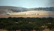 Turkish army tanks and Turkey-backed Syrian opposition forces move toward the Syrian border as pictured from Karkamis, Turkey, Wednesday, Aug. 24, 2016. Turkey's military launched an operation before dawn Wednesday to clear a Syrian border town from Islamic State militants, and a private Turkish TV station reported that a small number of Turkish special forces had crossed into Syria as part of the operation.The operation was launched hours before Vice President Joe Biden was due in Ankara for talks that include developments in Syria.(AP Photo)