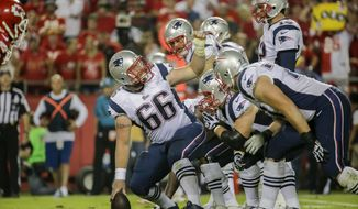 New England Patriots center Bryan Stork (66) prepares to snap the ball during the third quarter of an NFL football game against the Kansas City Chiefs Monday, Sept. 29, 2014, in Kansas City, Mo. (AP Photo/Charlie Riedel)