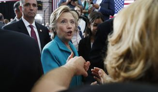 Democratic presidential candidate Hillary Clinton greets people in the audience at a campaign event at Truckee Meadows Community College in Reno, Nevada, on Aug. 25, 2016. (Associated Press)