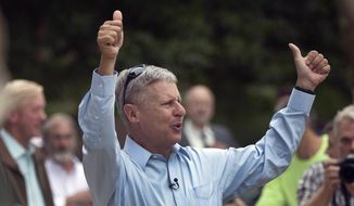 Former New Mexico governor, Libertarian presidential candidate Gary Johnson arrives to a cheering crowd of several hundred during a campaign rally Thursday, Aug. 25, 2016, in Concord, N.H. (AP Photo/Jim Cole)