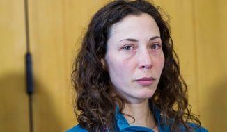 Czech tourist Pavlina Pizova attends a press conference at a police station in Queenstown, New Zealand, Friday, Aug. 26, 2016. Pizova, whose partner fell to his death, survived a harrowing month in the frozen New Zealand wilderness before being rescued, police said. (James Allan/New Zealand Herald via AP)