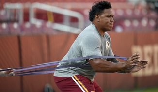 Washington Redskins guard Shawn Lauvao (77) warms up before an NFL preseason football game against the Buffalo Bills, Friday, Aug. 26, 2016, in Landover, Md. (AP Photo/Nick Wass)