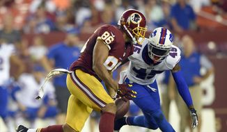 Washington Redskins tight end Jordan Reed (86) drops a pass as he is covered by Buffalo Bills cornerback Kevon Seymour (45) during the first half of an NFL preseason football game Friday, Aug. 26, 2016, in Landover, Md. (AP Photo/Nick Wass)