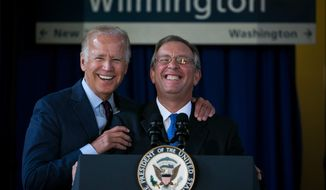 Anthony Coscia, right, Chairman of the Board for Amtrak, and Vice President Joe Biden enjoy a light moment at the Joseph R. Biden Jr. Railroad Station in Wilmington, Del., Friday, Aug. 26, 2016. Federal officials say the government will make a $2.45 billion loan to Amtrak to buy new trains, upgrade tracks and make platform improvements on the Northeast corridor. (Suchat Pederson/The Wilmington News-Journal via AP)