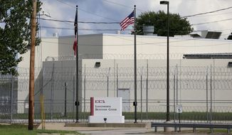 This Friday, Aug. 26, 2016 photos shows a look down Highway Terrace in Leavenworth, Kan., at the main gate of the Leavenworth Detention Center of Corrections Corporation of America. Defense attorneys who represent inmates at a privately run federal prison in Kansas were livid after learning that their meetings with clients had been recorded on video.(AP Photo/Orlin Wagner)