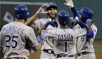 Kansas City Royals' Eric Hosmer, center, celebrates his three-run home run with Jarrod Dyson (1), Lorenzo Cain (6) and Kendrys Morales (25) in the first inning of a baseball game against the Boston Red Sox at Fenway Park, Friday, Aug. 26, 2016, in Boston. (AP Photo/Elise Amendola)