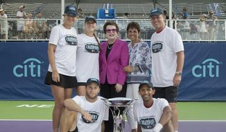 In a photo provided by World TeamTennis, Billie Jean King, center rear, and Ilana Kloss, CEO and commissioner of World TeamTennis, pose with, standing from left, Darija Jurak, Shelby Rogers and coach John Lloyd, and seated, from left, Ryan Harrison and finals MVP Raven Klaasen on Friday, Aug. 26, 2016, in New York. The Aviators beat the Orange County Breakers 25-14 for their first WTT title. (Matt Fitzgerald/Camerawork USA via World TeamTennis, via AP) **FILE**