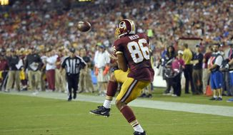 Washington Redskins tight end Jordan Reed (86) catches a pass and runs for a touchdown during the first half of an NFL preseason football game against the Buffalo Bills, Friday, Aug. 26, 2016, in Landover, Md. (AP Photo/Nick Wass)