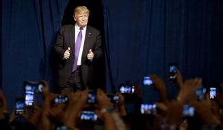 In this Feb. 23, 2016 file photo, Republican presidential candidate Donald Trump arrives for a caucus night rally in Las Vegas.  (AP Photo/Jae C. Hong, File)