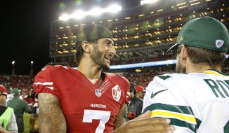 San Francisco 49ers quarterback Colin Kaepernick, left, greets Green Bay Packers quarterback Aaron Rodgers at the end of an NFL preseason football game Friday, Aug. 26, 2016, in Santa Clara, Calif. Green Bay won 21-10. (AP Photo/Tony Avelar)